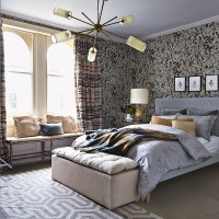 Pattern-rich bedroom in warming neutrals with feature light