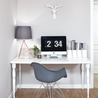Neutral home office with grey desk chair and table lamp