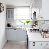 Stylish kitchen with re-painted units in blue-grey