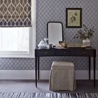 Cool grey bedroom with toning patterns and black dressing table