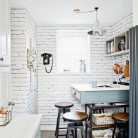 Industrial-style kitchen with white brick-effect wallpaper