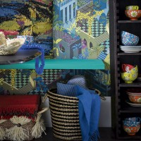 Jungle-themed dining room with tropical wallpaper and storage unit