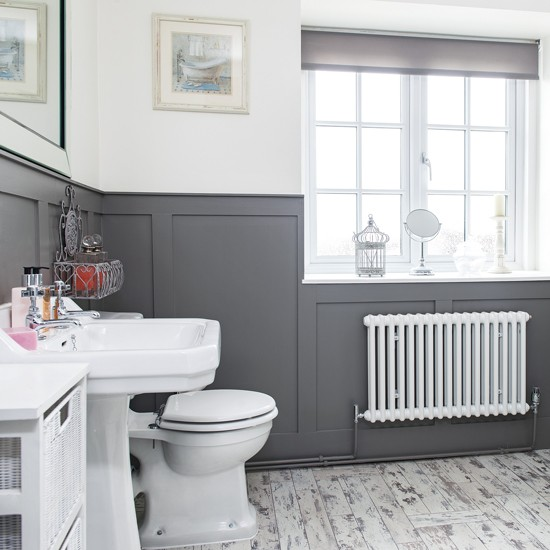 Modern bathroom with grey panelling and laminate flooring for Grey bathroom laminate flooring