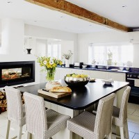 Modern kitchen with black dining table