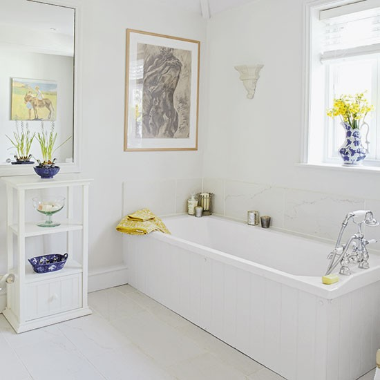 white bathroom with yellow and blue accessories. Black Bedroom Furniture Sets. Home Design Ideas