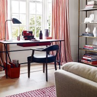 Modern home office with red striped curtains and patterned rug