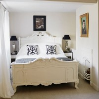 Classic bedroom with French-style bed in toning neutrals