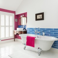 Modern bathroom with bold blue tiles and pink features