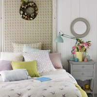Country bedroom with spring colours and feature headboard