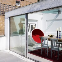 Modern conservatory with retro red chair