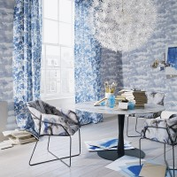 Blue dining room with watercolour wallpaper and pendant light
