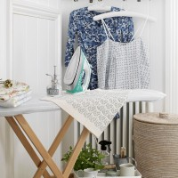 Country-style utility room with ironing station