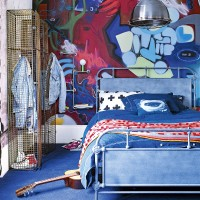 Modern bedroom with graphic textiles and graffiti wall