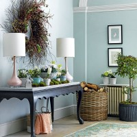Duck-egg blue hallway with console table and wreath