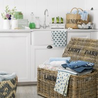 Super-organised utility room with wicker storage baskets