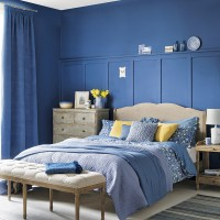Bedroom with indigo blue walls and textured linen
