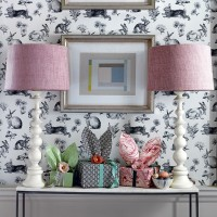 Spring-themed hallway with whimsical wallpaper and table lamps