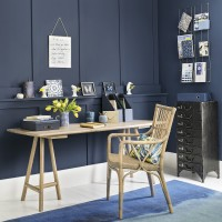 Moody-blue home office with white flooring