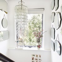 Bright and light hallway with collection of mirrors