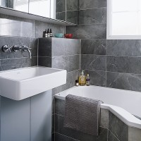 Modern bathroom with all-over grey tiling