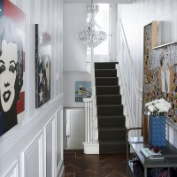Traditional white hallway with modern artworks