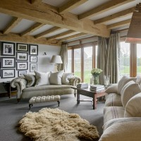 Barn-conversion living room with wooden beams