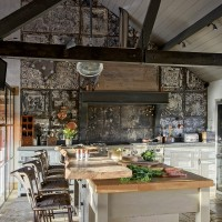 Barn kitchen with reclaimed tin wall tiles
