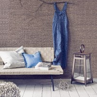 Living room with woven furniture and textured wall