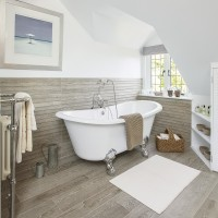 Scandi-inspired bathroom with roll-top bath and wood-effect tiles