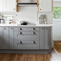 Contemporary kitchen with grey cabinetry and quartz worksurface