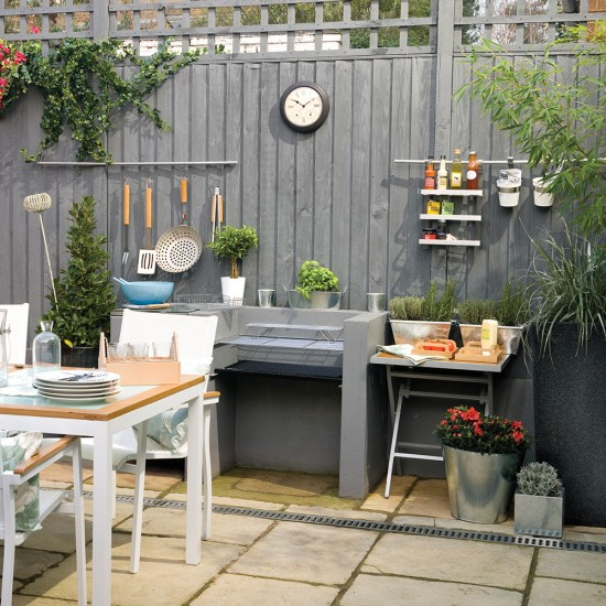 Garden fence painted grey with cooking station garden - Painting garden fence colours ...