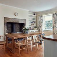 Country-style dining area with huge fireplace
