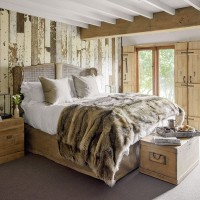 Rustic country bedroom with reclaimed wood wall