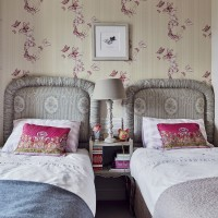 Children's room with twin beds and feature wallpaper