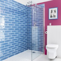 Colourful shower room with blue metro tiles and pink wall