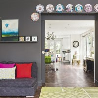 Modern grey living room with bright accessories