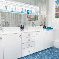 Blue and white bathroom with mirrored mosiac tiles
