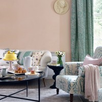 Pastel living room with upholstered sofa and armchair