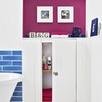 Modern bathroom with pink wall and built-in storage