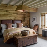 Country bedroom with wooden feature wall