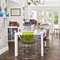 Modern white dining room with colourful chairs