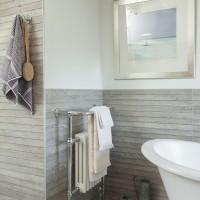 Modern bathroom with grey wood effect tiling
