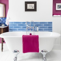 Modern bathroom with blue tiled wall and pink accessories