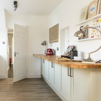 Contemporary kitchen with wooden worktops and open shelving