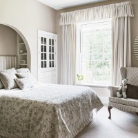 Smart bedroom in neutral shades and delicate florals