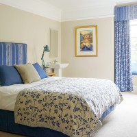 Light-filled bedroom with cornflower blue touches