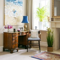 Home-office corner with traditional desk and blue table lamp