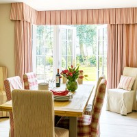 Warm-toned dining room with pelmet curtains in subtle stripes
