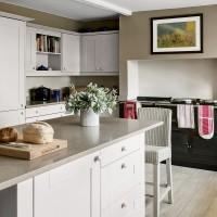 Spacious neutral kitchen with black Aga