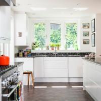 Modern white kitchen with black worktops